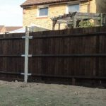 feather edge fence, garden fencing, concrete posts, dark stain