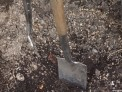 garden fork and garden spade in soil