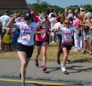 Hari and Erin racing to the finish line, race for life, cancer research, plews girls, hari waterfield, erin corbett, blackheath