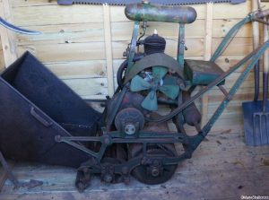 old petrol lawn mower, World War 2 garden shed, dig for victory display, Trengwainton, Cornwall, Cornish gardens