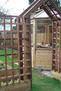 octagonal greenhouse, arch, trellis, vegetable area with raised beds and wooden greenhouse, grow your own