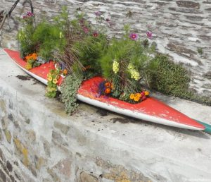 annual bedding using old canoe as planter