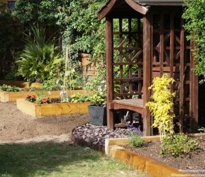 raised vegetable beds, slate seating area with arbour, family friendly garden