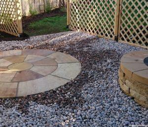 indian sandstone circular patio, dry stone wall fire pit, trellis fence, decorative pebbles, landscaper, garden design, garden project