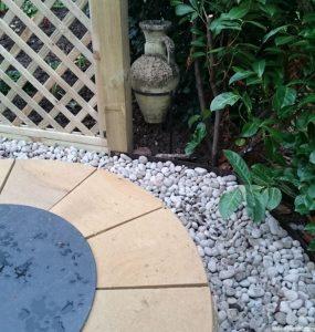 circular fire pit, with cover, trellis fence, stone urn, garden designer, landscaper, garden project, kent