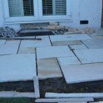curved edge indian sandstone patio being laid, landscaper, garden design, garden project in progress