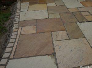 newly laid curved edge indian sandstone patio, landscaper, garden design, garden project