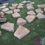 building the fire pit, drystone wall fire pit