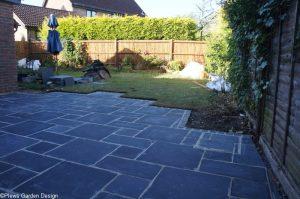 black limestone patio art deco edge, pale grey pointing, newly laid, garden project in progress, stonemason, landscaper