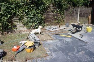 black limestone patio in progress, stonemason, landscaper, plews, pet dog, small white dog