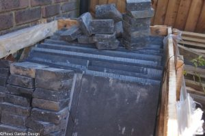 black limestone setts and black limestone pavers in pallet, garden project, garden designer, landscaper