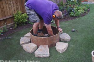 nathan in fire pit, Nathan Waterfield, Plews Garden Design, landscape gardener