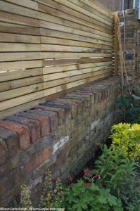 horizontal slatted fence, brick wall, wheelchair friendly garden, edible ornamental garden, garden fence, garden fencing